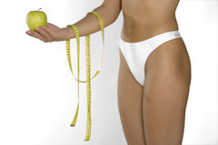 Apple and beautiful body Royalty Free Stock Images