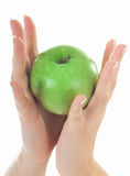 Apple in beautiful hands Royalty Free Stock Images
