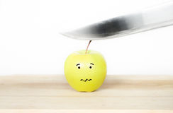 Apple being sliced Royalty Free Stock Images