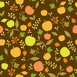 Apple, berries and leaves on brown background Royalty Free Stock Photos