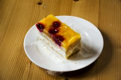 Apple and berry cheese cake swiss style on dish in restaurant Royalty Free Stock Photos