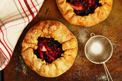 Apple and berry galette topped with sugar Stock Photos