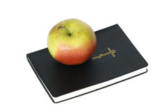 Apple on Bible Royalty Free Stock Images