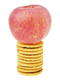 Apple on biscuit Royalty Free Stock Images