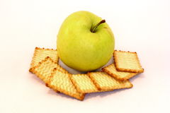 Apple and biscuits Stock Photography