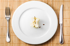 Apple bit on the plate Royalty Free Stock Photos