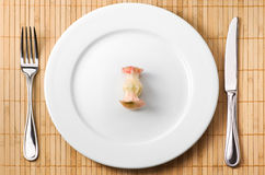Apple bit on the plate Royalty Free Stock Images