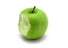 Apple Bite. Green apple with water drops and bite stock images