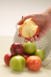 Apple bite. From a bunch of many colour apples stock photos