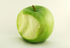Apple Bite. A apple with a bite taken out of it royalty free stock image