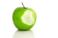 Apple bite. Bite taken out of a green apple Stock Photography