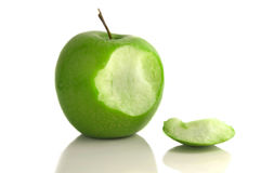 Apple bite. Green apple with bite taken out, on white Royalty Free Stock Photo