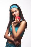 apple biting red sporty woman Στοκ φωτογραφία με δικαίωμα ελεύθερης χρήσης
