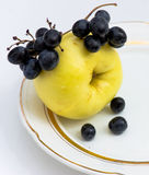 Apple and black grapes Royalty Free Stock Photos