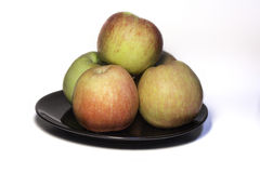 Apple on Black Plate. Stock Photos