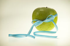 Apple with blue-white ribbon Stock Photo