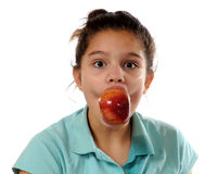 Apple Bobbing Success. Close-up portrait of a preteen girl whose been successful in bobbing for apples Royalty Free Stock Images