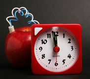 Apple bomb. Apple with a timer attached, fruit explosion stock photography