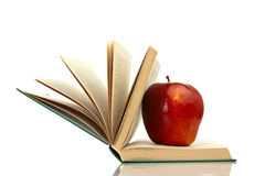 Apple on a book. Red apple on the half-open book Stock Image