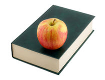 Apple on book Stock Photo
