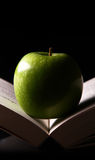 Apple on a book Stock Image