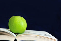 Apple on the book Stock Photography
