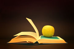 Apple on a book Royalty Free Stock Photo