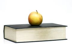 Apple on Book. An apple on top of an old book Royalty Free Stock Photo