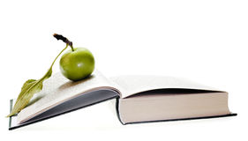 Apple and book Stock Images