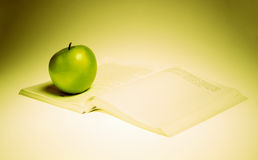 apple and book Stock Photography