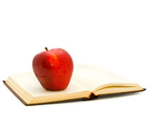 Apple on the book Stock Image