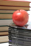 Apple, book and cd Royalty Free Stock Photography
