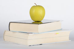 Apple on the book. Apple on the closed book on white background Royalty Free Stock Photography