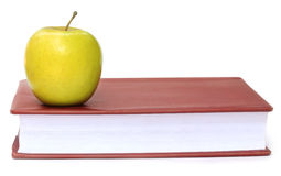 Apple on a book Royalty Free Stock Image