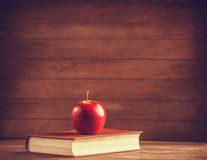 Apple and the book. Stock Image