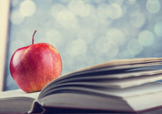 Apple and the book. Royalty Free Stock Image