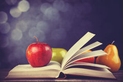 Apple and the book. Royalty Free Stock Photos