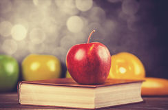 Apple and the book. Stock Images
