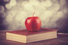 Apple and the book. Royalty Free Stock Photography
