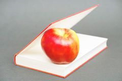Apple in a book Royalty Free Stock Images