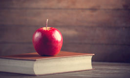 Apple and book Royalty Free Stock Images