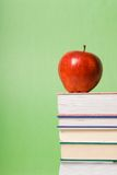 Apple and books Stock Images