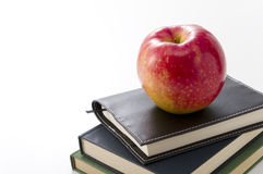 Apple on books Stock Photo