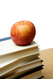 Apple and books Royalty Free Stock Photo