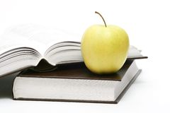 Apple and books. Two books and apple, isolated on white royalty free stock images