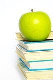 Apple and books Stock Photography