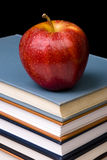 Apple on Books. A red apple on a stack of books viewed at an angle Royalty Free Stock Photography