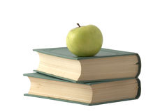 Apple on the books. Green apple on the books with green cover isolated over white Stock Image