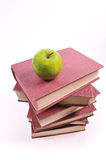 Apple and books Royalty Free Stock Image