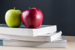 Apple on books Royalty Free Stock Photo